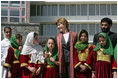 Mrs. Bush stands with a group of Afghan girls upon her arrival in Kabul, Afghanistan, Tuesday, March 29, 2005.