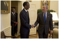 President George W. Bush meets with the President Paul Kagame of Rwanda in the Oval Office Friday, April 15, 2005.
