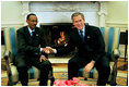 President George W. Bush meets with President Paul Kagame of Rwanda in the Oval Office Tuesday, March 4, 2003.