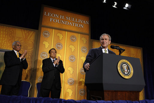 President George W. Bush receives applause during his remarks to The Leon H. Sullivan Foundation Tuesday, Feb. 26, 2008, in Washington, D.C. Joining the President on stage are Ambassador Andy Young, Chairman of the Board, Leon H. Sullivan, background center, and Ambassador Howard Jeter, president and CEO of The Leon H. Sullivan Foundation. White House photo by Eric Draper