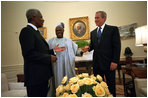 President George W. Bush meets with United Nations Secretary General Kofi Annan, left, and President Olusegun Obasanjo of Nigeria in the Oval Office May 11, 2001. President Bush.s commitment to Africa started long before the announcement of his plan to fight AIDS. He has met with 25 African heads of state and has a wide range of discussions about HIV/AIDS, economy and peace in the region.