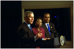 President George W. Bush discusses Global and Domestic HIV and AIDS during a meeting in the Dwight D. Eisenhowser Executive Office Building Jan. 31, 2003. Pictured with the President are Ambassodor Edith Ssempala of Uganda, center, and Ambassador Odeen Ishmael of Guyana.