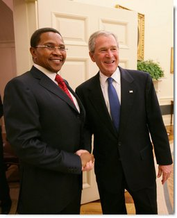 President George W. Bush welcomes Tanzania President Jakaya Kikwete to the Oval Office Friday, Aug. 29, 2008, where the two leaders held discussions on their bilateral relations. President Bush also thanked President Kikwete for his gracious hospitality during the President and Mrs. Bush's visit to Tanzania early this year in February.  White House photo by Chris Greenberg