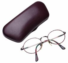 Photograph of eye glasses with case