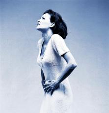 Photograph of a woman clutching her stomach in pain