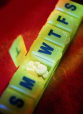 Photograph of a pill organizer containing pills