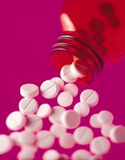 Photograph of pills poured from a bottle