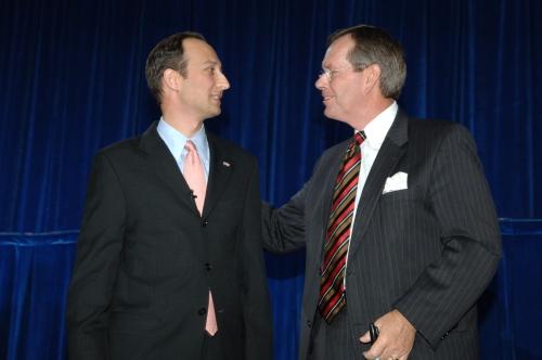 Secretary Mike Leavitt congratulates Deputy Secretary Troy after the swearing-in ceremony.