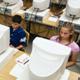 children in computer lab working