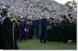 President George W. Bush walks through graduating seniors as he enters Paladin Stadium to give the commencement address to the Class of 2008 at Furman University in Greenville, SC.  White House photo by Chris Greenberg
