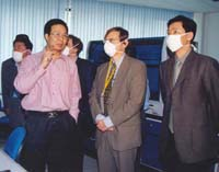 Dr. Lipkin, center, at the Chinese Academy of Military Medicine during the 2003 SARS outbreak. To the left is molecular biologist Ruifu Tang; at the far left is Chen Zhu, current Chinese Minister of Health. On the right is an interpreter. (Credit: Ian Lipkin)