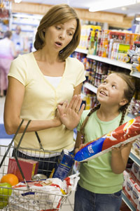 photo of mom and daughter grocery shopping