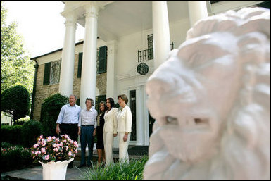 President George W. Bush, Laura Bush and Japanese Prime Minister Junichiro Koizumi are welcomed to Graceland, the home of Elvis Presley, by his former wife Priscilla Presley and their daughter Lisa-Marie Presley, Friday, June 30, 2006 in Memphis. White House photo by Eric Draper .
