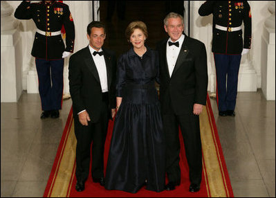 President George W. Bush and Mrs. Laura Bush stand with President Nicolas Sarkozy of France on the North Portico of the White House after his arrival for dinner Tuesday, Nov. 6, 2007.