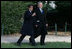 President George W. Bush and President Nicolas Sarkozy share a moment as they walk to a joint press availability Wednesday, Nov. 7, 2007, at Mount Vernon. The tour of the Virginia home of George Washington coincided with a series of meetings by the two leaders during the visit by the French leader to the United States.