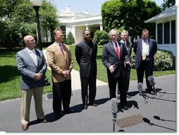 President George W. Bush speaks to reporters with NCAA head football coaches, from left to right, Jack Siedlecki of Yale University, Mark Richt of the University of Georgia, Randy Shannon of the University of Miami, Tommy Tuberville of Auburn University and Charlie Weis of the University of Notre Dame on Monday, May 26, 2008, at the White House. President Bush welcomed the coaches who were recently returning from visiting troops in the Middle East. White House photo by Chris Greenberg