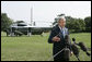 President George W. Bush addresses reporters on the South Lawn of the White House Sunday, July 30, 2006, saying America will work together with members of the United Nations Security Council to develop a solution that will bring a sustainable peace to the conflict in Lebanon. White House photo by Paul Morse