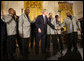 President George W. Bush joins the Temptations on stage in the East Room of the White House Tuesday, Feb. 12, 2008, after they performed during the celebration of African American History Month. White House photo by Eric Draper