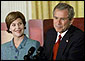 President George W. Bush and Laura Bush discuss the importance of involving families and teachers to help children read at an early age in the East Room Wednesday, April 3. Promoting the Early Childhood Education Initiative, Mrs. Bush is the honorary national chairperson of the PBS Designated Reader campaign. After their remarks, the audience of adults and children were visited by Mister Rogers and Elmo from Sesame Street. White House photo by Evan Parker.