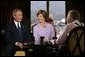 President George W. Bush and Mrs. Bush participate in an interview with Larry King, right, in Los Angeles, Calif., Thursday, Aug. 12, 2004.  White House photo by Eric Draper