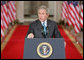 "President George W. Bush emphasizes a point Wednesday Sept. 6, 2006 in the East Room of the White House, as he discusses the administration's draft legislation to create a strong and effective military commission to try suspected terrorists. The bill being sent to Congress, said President Bush, ""reflects the reality that we are a nation at war, and that it is essential for us to use all reliable evidence to bring these people to justice."" White House photo by Kimberlee Hewitt"