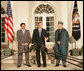 President George W. Bush stands with President Pervez Musharraf of the Islamic Republic of Pakistan, left, and President Hamid Karzai of the Islamic Republic of Afghanistan, Wednesday evening, Sept. 27, 2006, in the Rose Garden at the White House speaking to reporters prior to the three leaders attending a private dinner. White House photo by David Bohrer