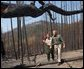 President George W. Bush tours the Squires Peak Fire Area in Medford, Ore., with Ron Wenker of the Medford Bureau of Land Management Properties District, Thursday, Aug. 22, 2002.