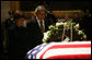 President George W. Bush and Mrs. Laura Bush stand next to the catafalque holding the flag-draped casket of former President Gerald R. Ford Monday, Jan. 1, 2007, in the Rotunda of the U.S. Capitol as they pay their final respects to the 38th President of the United States. White House photo by Eric Draper