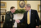 President George W. Bush welcomes Army General David Petraeus, incoming Commander of the Multi-National Force-Iraq, Friday, Jan. 26, 2007, to the Oval Office. White House photo by Eric Draper
