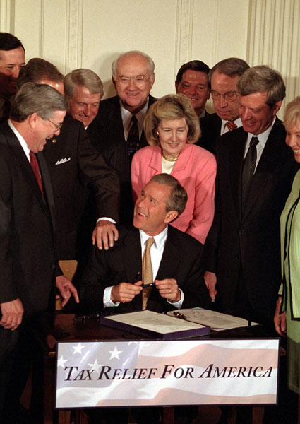 President George W. Bush signs the tax bill on Thursday, June 7 in the White House.