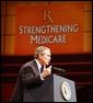 "President George W. Bush addresses the audience at Devos Performance Hall in Grand Rapids, Mich., Wednesday, Jan. 29, 2003. ""I urged the Congress last night to put aside all the politics and to make sure the Medicare system fulfills its promise to our seniors,"" President Bush said. ""I believe that seniors, if they're happy with the current Medicare system, should stay on the current Medicare system. That makes sense. If you like the way things are, you shouldn't change. However, Medicare must be more flexible. Medicare must include prescription drugs.""  White House photo by Tina Hager"