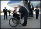 President George W. Bush greets Marine Corps Lt. Andrew Kinard, a 24-year-old from Spartanburg, S.C., after arriving Friday, Nov. 2, 2007, at Columbia Metropolitan Airport in Columbia, S.C. The Marine was wounded in 2006 while serving in Iraq. White House photo by Eric Draper