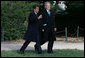 President George W. Bush and President Nicolas Sarkozy share a moment as they walk to a joint press availability Wednesday, Nov. 7, 2007, at Mount Vernon. The tour of the Virginia home of George Washington coincided with a series of meetings by the two leaders during the visit by the French leader to the United States. White House photo by Chris Greenberg