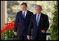 President George W. Bush and Prime Minister Tony Blair walk along the colonnade before a press conference in the Rose Garden of the White House on April 16, 2004.  White House photo by Paul Morse