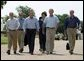 After talking with the press, President George W. Bush walks with his economic advisors�at his ranch�in Crawford, Texas, Wednesday, August 13, 2003. Pictured are, from left,�Director of the Office of Management and Budget Josh Bolten, Assistant to the President for Economic Policy Stephen Friedman, Secretary of Commerce Don Evans, Secretary of Labor Elaine Chao and Secretary of the Treasury John Snow.�  White House photo by Susan Sterner