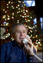 President George W. Bush makes Christmas Eve telephone calls to members of the Armed Forces at Camp David, Sunday, Dec. 24, 2006.  White House photo by Eric Draper