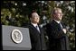 President George W. Bush and Premier Wen Jiabao of China stand for the playing their national anthems during an Arrival Ceremony on the South Lawn Tuesday, Dec. 9, 2003.   White House photo by Paul Morse