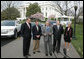 President George W. Bush talks to the media after a demonstration Monday, March 26, 2007, of alternative fuel vehicles on the South Lawn drive of the White House. Standing with him from left, are: Rick Wagoner, Chairman and CEO, General Motors Corporation; Alan Mulally, President and CEO, Ford Motor Company; Tom LaSorda, President and CEO, DaimlerChrysler Corporation, and Secretary of Transportation Mary Peters. White House photo by Joyce N. Boghosian