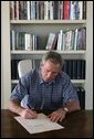 "President George W. Bush signs into law H.R. 3010, the ""Departments of Labor, Health and Human Services, and Education, and Related Agencies Appropriations Act, 2006"" from the Bush ranch Friday, Dec. 30, 2005, in Crawford, Texas.  White House photo by Shealah Craighead"