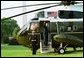 President George W. Bush waves from Marine One as he departs the White House Friday, May 7, 2004.  White House photo by Paul Morse