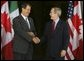 President George W. Bush greets Mexican President Vicente Fox at the beginning of meetings between the United States, Mexico and Canada at Baylor University in Waco, Texas, Wednesday, March 23, 2005.  White House photo by Krisanne Johnson