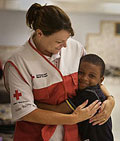 Port Allen, Louisiana. Red Cross volunteer Martha Teaster receives a big hug from Jason Wase in Erwinville Community Center shelter. Talia Frenkel/American Red Cross.
