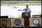 President George W. Bush delivers his remarks on immigration reform from a stage along the Rio Grande River on the U.S.-Mexico border Thursday, Aug. 3, 2006, at the Anzalduas County Park and Dam in Mission, Texas.  White House photo by Eric Draper