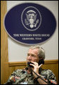 President George W. Bush speaks with the Prime Minister of Lebanon during a phone call at the Bush Ranch in Crawford, Texas, Saturday, Aug. 12, 2006. White House photo by Eric Draper