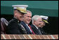 President George W. Bush attends an Armed Forces farewell tribute in honor of Marine General Peter Pace, left, and Armed Forces hail in honor of Navy Admiral Michael Mullen, far right, joined by Secretary of Defense Robert Gates, Monday, October 1, 2007 at Fort Myer, Virginia. General Pace is retiring after serving two years as Chairman and four years as Vice Chairman of the Joint Chiefs of Staff. White House photo by David Bohrer