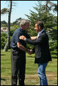 President George W. Bush greets President Nicolas Sarkozy of France upon his arrival to Walker's Point Saturday, August 11, 2007, in Kennebunkport, Maine. White House photo by Shealah Craighead
