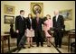 President George W. Bush is joined by Texas Senators Kay Bailey Hutchison, second from right, and John Cornyn, right, and Senate Leader Bill Frist (R-Tenn.), as they stand with Judge Priscilla Owen Tuesday, May 24, 2005, in the Oval Office.  White House photo by Eric Draper