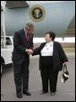 President George W. Bush talks with USA Freedom Corps Greeter Dolly Yunkunis in front of Air Force One in Wilkes-Barre, Pennsylvania, Friday, Oct. 22, 2004.   White House photo by Eric Draper