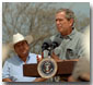 President Bush speaks to the media and local farmers during a signing for a farm relief bill at his ranch in Crawford, Aug. 13, 2001. White House photo by Moreen Ishikawa.