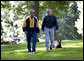 President George W. Bush and Chief of Staff Josh Bolten walk together with the President's dog, Barney, at Camp David, Saturday, July 21, 2007. White House photo by Eric Draper